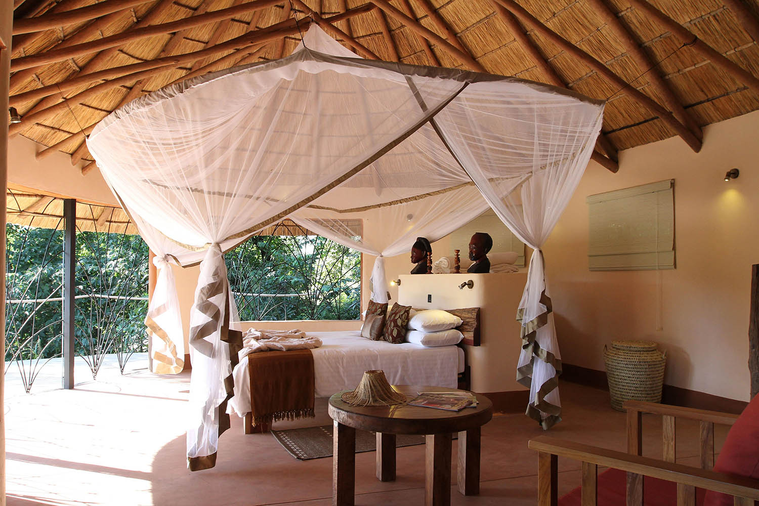 tongole wilderness lodge malawi-lodges-malawian-style-nkhotakota-rooms-bed-table