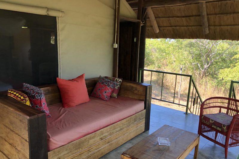 rafiki safari camp - malawi-lodges-malawian-style-nkhotakota-wildlife-reserve-comfortable-chalets-living-area-outside