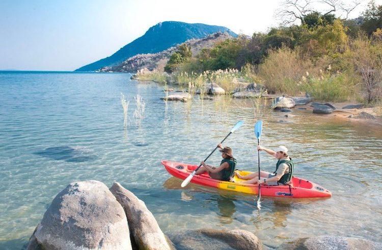 family on kayak in malawi